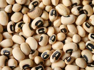 image: A photograph of a bowl full of black eyed peas.