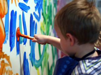image: A photograph of a child painting.