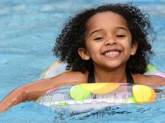 image: A photograph of a child swimming.