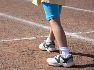 image: A photograph of a child getting ready to run on a track.
