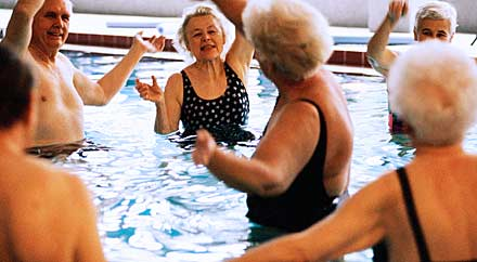 image: A photograph of seniors exercising in a pool.