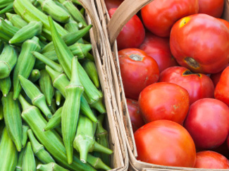 image: A photograph of baskets of tomatoes and okra.