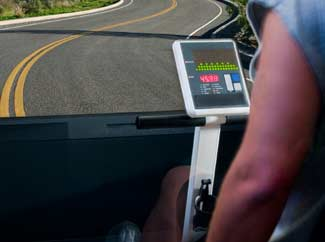 image: A photograph of a cyclist sitting in front of a simulator screen.